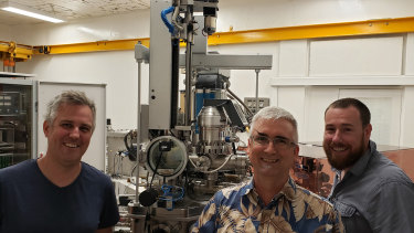 Curtin University researchers Associate Professor Nick Timms (left), Senior Research Fellow Dr Aaron Cavosie (centre), and Professor Chris Kirkland (right), pictured with the instrument used for dating the impact: A sensitive high resolution ion microprobe.