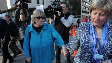 Jane's sister Lee Rimmer walks through the media pack towards the District Court.