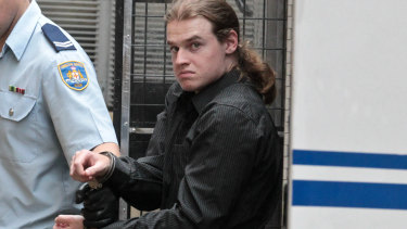 Daniel Chapman is led into the courts on Friday afternoon.