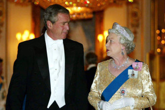 The Queen arrives with US president George W. Bush in London, 2003, for a Buckingham Palace state banquet.