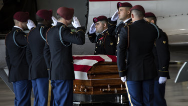 A US Army carry team moves the transfer case containing the remains of Army Spc Michael Nance in Chicago. Two more US members have been killed since Nace died in late July.