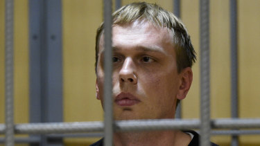 Ivan Golunov, a prominent investigative journalist, sits in a cage in court in Moscow on Saturday.