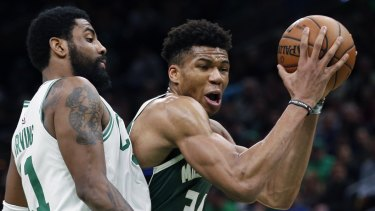 Bucked: MVP favourite Giannis Antetokounmpo (right) had another monster game for Milwaukee.
