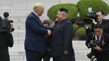 US President Donald Trump walks to the North Korean side of the border with North Korean leader Kim Jong-un at the border village of Panmunjom.