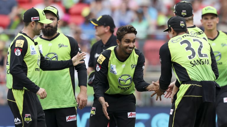 Back in the game: Arjun Nair celebrates taking the wicket of Ben Laughlin.