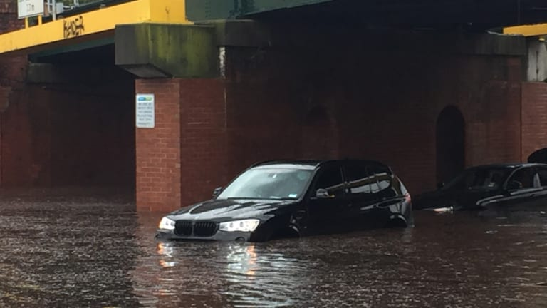 Two cars stuck under York Street Bridge in South Melbourne.
