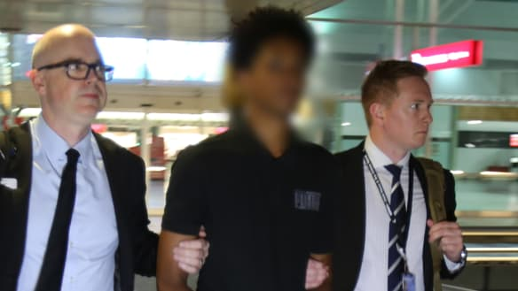 AFP officers arrested the man after he arrived at Adelaide Airport on an international flight.