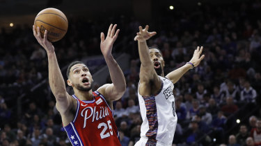 Philadelphia 76ers' Ben Simmons drives to the basket past Brooklyn Nets' Spencer Dinwiddie to score.
