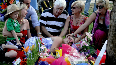 Family and friends gather around Bianca Girven's mother Sonia Anderson in 2010.