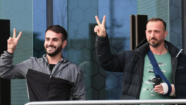 Al Noor Mosque shooting survivors Mustafa Boztas and Temel Atacocugu greet wellwishers outside the High Court in Christchurch as they arrive for the sentencing of the Australian terrorist.
