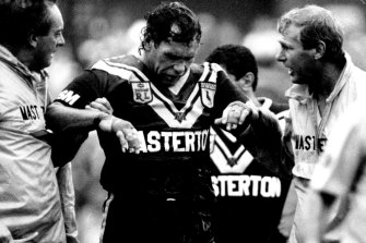 Gibbs leaves the field after suffering another head knock playing for Wests in 1992.