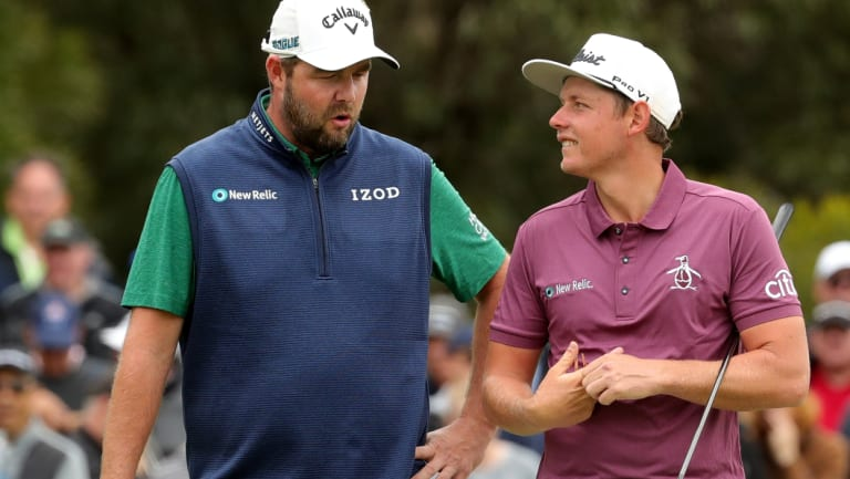 Caught short: Australian's Marc Leishman, left, and Cameron Smith talk tactics ahead of a putt on the third hole of the final day at The Metropolitan.