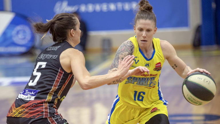 Bendigo's Nat Hurst (right) drives forward, with the WNBL title race too close to call.
