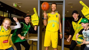 Setting a screen: Australian Boomers' Matthew Dellavedova demonstrates the airport-style security arrangements that will be used for the two-game series against USA Basketball at Marvel Stadium in Melbourne.
