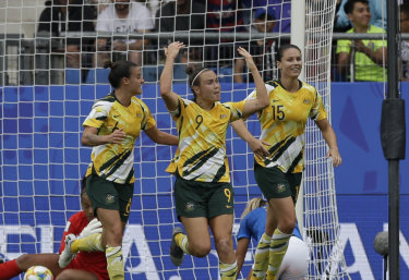 Caitlin Foord celebrates scoring Australia's  first goal against Brazil.