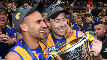 Dom Sheed (L) and McGovern celebrate their premiership.