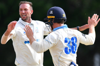 NSW paceman Trent Copeland (left) celebrates with Daniel Solway after taking a wicket on Thursday.