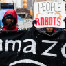 'We can see your greedy side': Amazon critics rally outside Jeff Bezos' New York penthouse