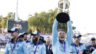 Jos Buttler lifts the trophy as England celebrate their remarkable win over New Zealand.