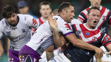 Better late than never: Cameron Smith tackles Boyd Cordner but ultimately came off second-best on the night.