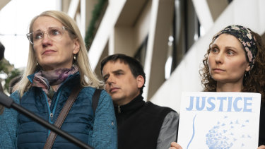 """Sarah Kuhnen, in blue, and other """"Justice for Justine"""" activists outside the Minneapolis courtroom this week."""