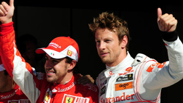 Ferrari's Fernando Alonso (left) with  McLaren Mercedes' Jenson Button in Italy during their Formula One heyday.
