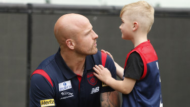 Nathan Jones, pictured with his young son Remy.