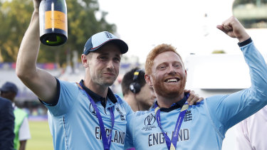 Chris Woakes (left) and Jonny Bairstow celebrating their World Cup triumph.
