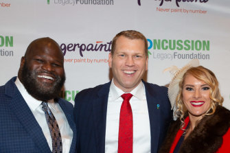 Chris Nowinski (centre) with WWE stars Mark Henry and Lacy Evans at the annual Concussion Legacy Gala in October.