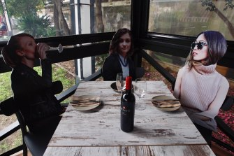Life-sized cardboard cut-outs make this Sydney restaurant feel a bit less sparsely populated while helping owners maintain social distancing.