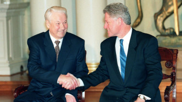 US President Bill Clinton, right, and his Russian counterpart Boris Yeltsin shake hands at the Helsinki Summit to discuss NATO expansion in 1997.