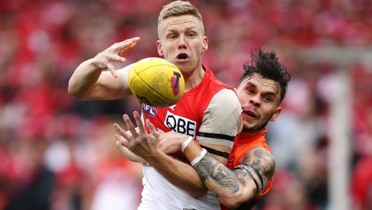 Seamless: Despite his long layoff, defender Zac Williams (right) was solid for the Giants.