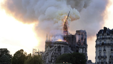 Flames and smoke rise as the spire on Notre-Dame Cathedral collapses.