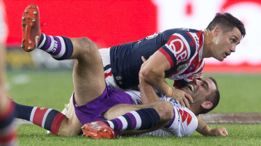 Cooper Cronk and Cameron Smith collide in the 2018 grand final.