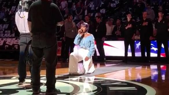 Singer takes knee during US national anthem at NBA game