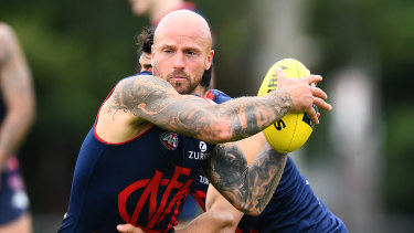 Nathan Jones is tackled during a Melbourne Demons training session back in March.