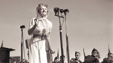 Entertainer Gracie Fields singing at her concert at the Sydney Showground on 13 August 1945