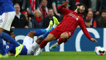 Hamza Choudhury collides with Mohamed Salah.