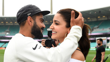 Indian captain Virat Kohli celebrates with his wife Anushka Sharma as they celebrate a 2-1 series victory over Australia following play being abandoned in the Fourth Test match between Australia and India at the SCG in Sydney, Monday, January 7.