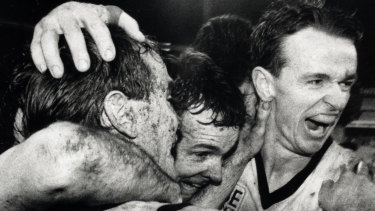 Full time ... Brothers Anthony and Terry Daniher join Barry Mitchell to celebrate NSW's win at the SCG last night.