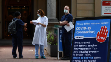In the COVID firing line: Staff outside the Royal Prince Alfred Hospital in Camperdown, Sydney.
