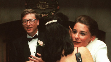 In 1994, as newlyweds, Bill Gates and Melinda French greet guests in a reception line at a private estate in Seattle.