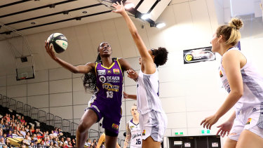Easy does it: Melbourne Boomers' Ezi Magbegor racks up more points against the Lightning.