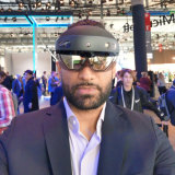 HoloLens 2 is comfortable to wear. You just slip it on like a baseball cap.