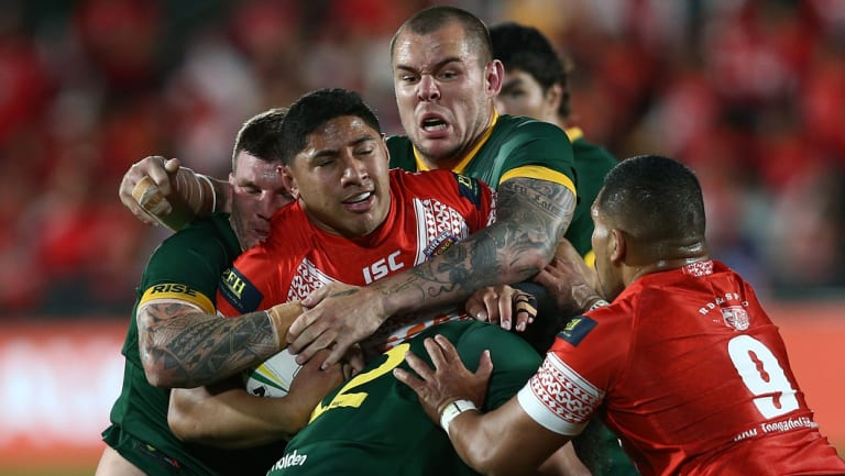 Surrounded: David Klemmer wraps up Jason Taumalolo with a bit of help.