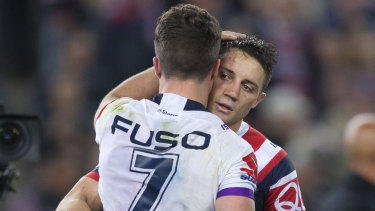 Cooper Cronk and Brodie Croft share a moment after last year's grand final.