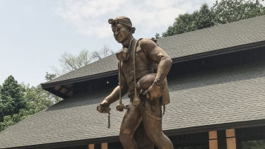A statue of Saman Gunan, the former Thai Navy Seal who died during the rescue of the Wild Boars soccer team