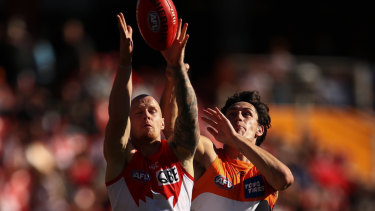 Derby day: Sydney's Zak Jones goes up against Jake Stein of the Giants.