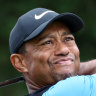 Tiger Woods three shots clear in Japan