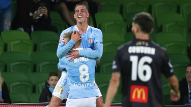 Finishing touch: Lachlan Wales celebrates with Riley McGree after scoring City's third goal late in the game.